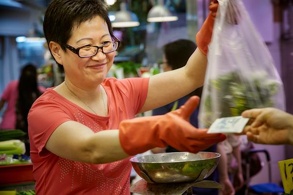 Making a sale in Tai Yuen market in Tai Yuen, Hong Kong