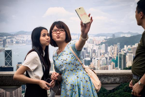 Tourists taking selfies on Victoria Peak in Hong Kong