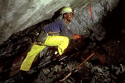 Gold miner at work underground - South Africa