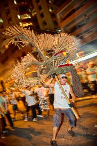 Running with the head of the dragon at the annual Tai Hang Fire Dragon Dance in Tai Hang, Hong Kong
