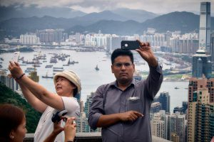 Tourists taking selfies of themselves on Victoria Peak in Hong Kong