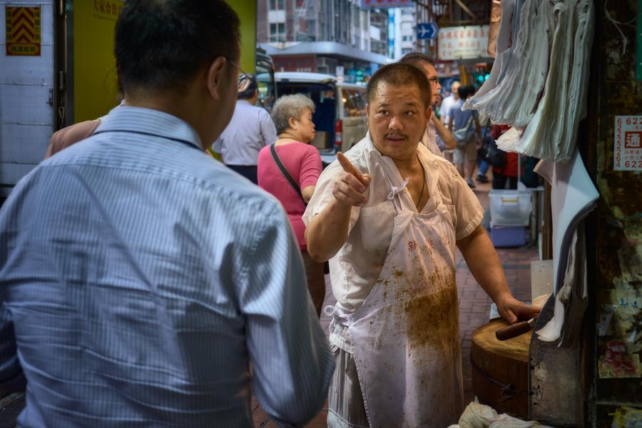 Placing an order at cooked foods shop on Shanghai Street in Yau Ma Tei, Hong Kong